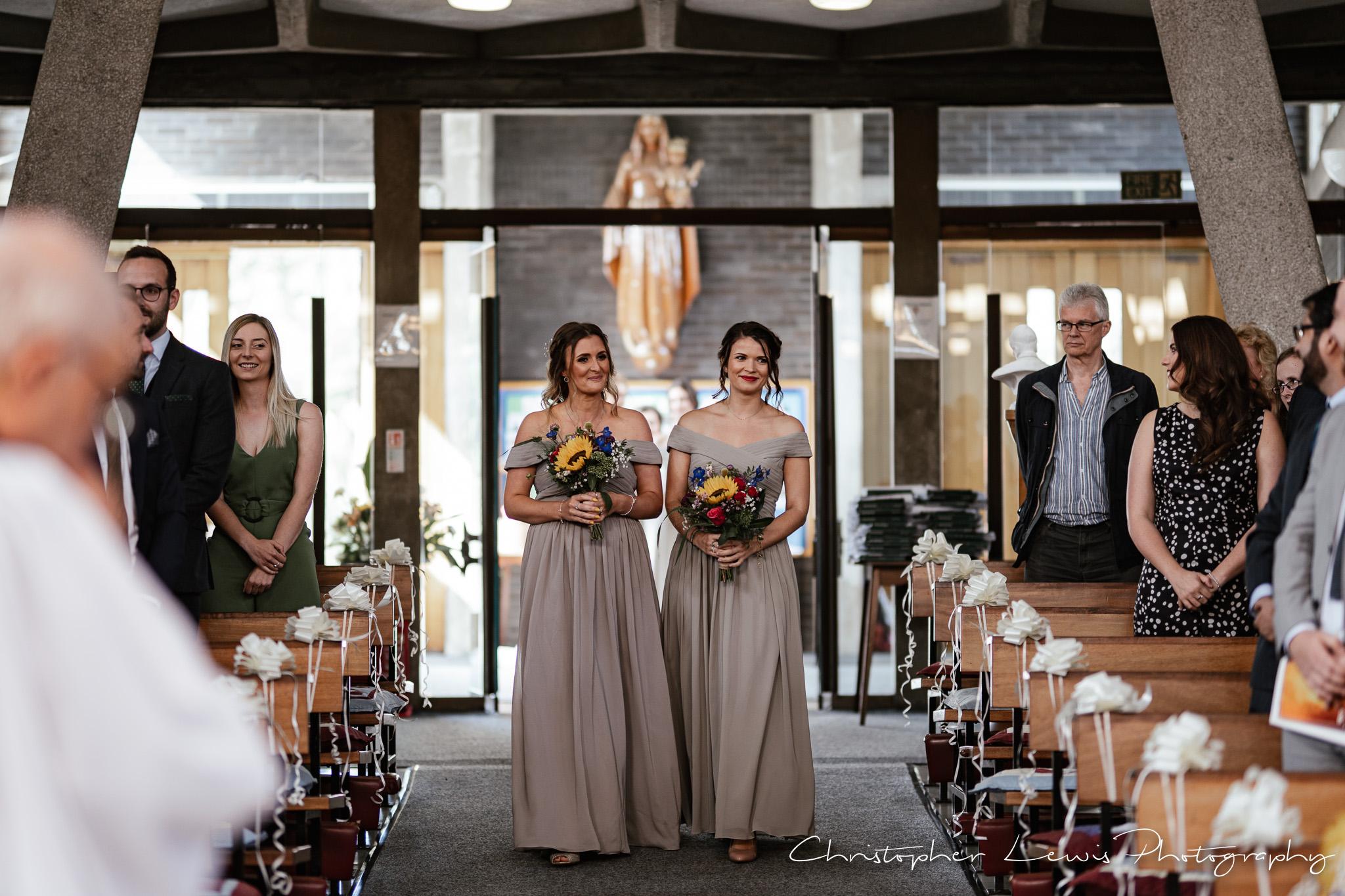 Samlesbury Hall Wedding bridesmaids going down aisle